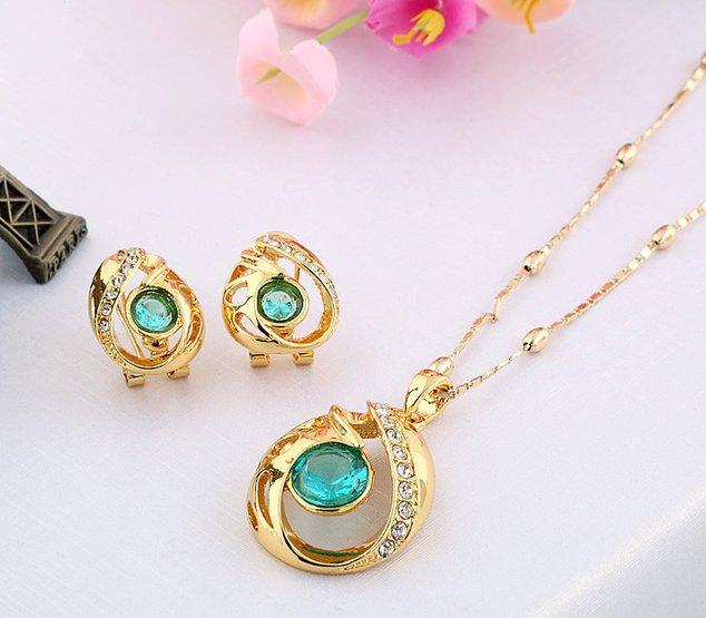 золотые украшения с камнями фото